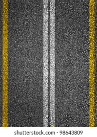 Road texture with white and yellow stripes