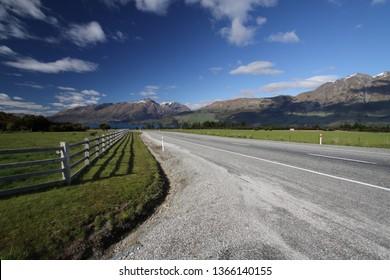 Road through beautiful landscape outside Glenorchy, New Zealand