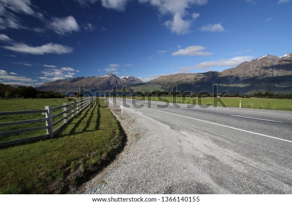Road through beautiful landscape outside Glenorchy, New Zealand