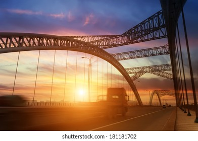 road through the bridge with sky background of a city