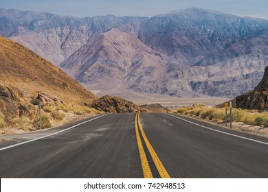 The road through Death Valley National Park, with the Panamint Mountains in the background.