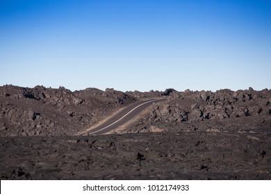 Road through Lava field at Big Island Hawaii