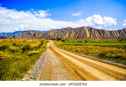 The road through the mountain valley. Mountain valley road landscape. Road in mountain valley. Valley road in mountains - Shutterstock ID 1976503763