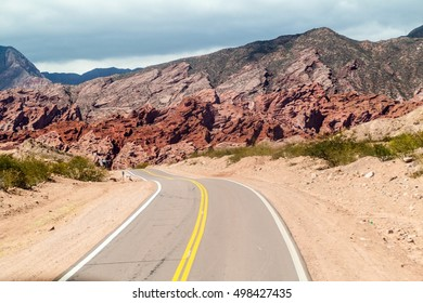Road through Quebrada de Cafayate valley, which is full of colorful rock formations, northern Argentina.