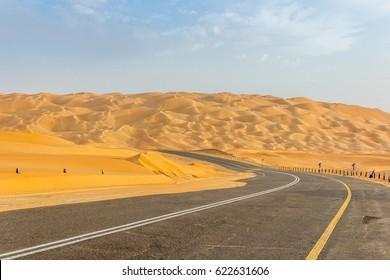 Road through sand dunes of the Rub' al Khali desert in Abu Dhabi emirate, United Arab Emirates