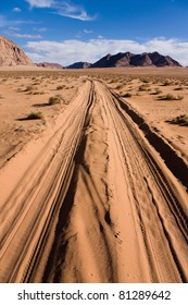 Road through the sands of the Wadi Rum desert in Jordan