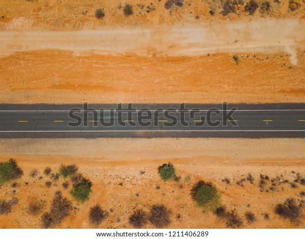 Road through savanna desert. Western Africa highway. Ethiopia