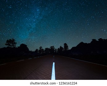 Road through Teide National Park at the Island of Tenerife under stars