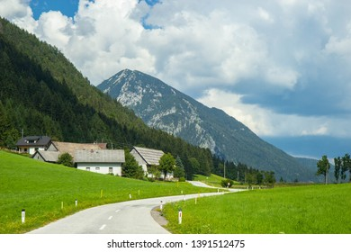 a road  through a valley in austrian Alps, Carinthia region near border with Slovenia