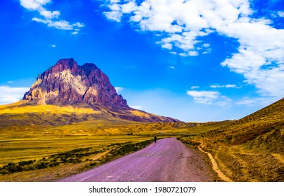 The road through the valley to the mountain top. Mountain valley road landscape. Road in mountain valley - Shutterstock ID 1980721079