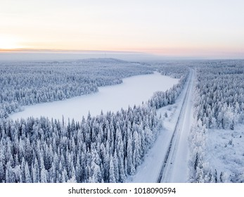 Road through winter wonderland in Finnish Lapland. Winter scenery. Landscape photo captured with drone above winter wonderland.