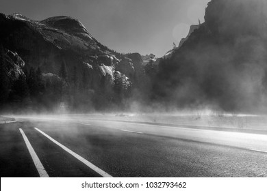 Road through Yosemite Valley in the morning mist in black and white