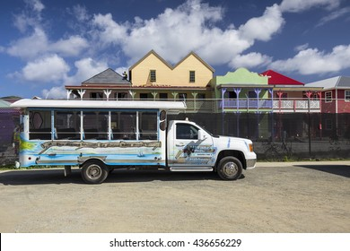Road Town, British Virgin Islands - January 05, 2016: Street landscape with tourist shuttle in Road Town. Tortola in the Caribbean Sea