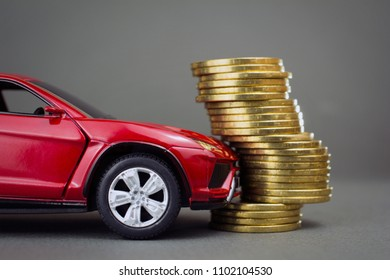 road traffic accident, car insurance concept. red car hit pile of coins