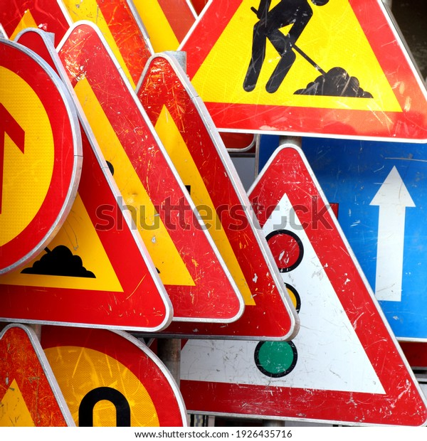 Road and traffic signs on the pile