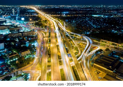 Road traffic transportation timelapse. Road and Roundabout, multilevel junction motorway, multiple roads in city, vehicular intersection, expressway with important infrastructure.
