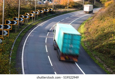 Road transport. Lorries blurred in motion on the road