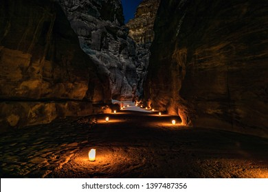 The road to Treasury (Al Khazneh) of Petra Ancient City is lit by candles all the way.