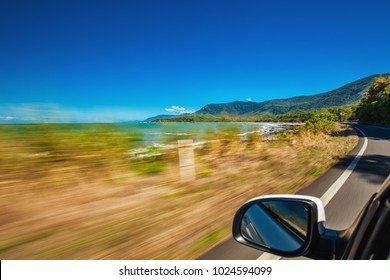 Road trip with motion blur along Ellis Beach near Palm Cove and Cairns, Queensland, Australia