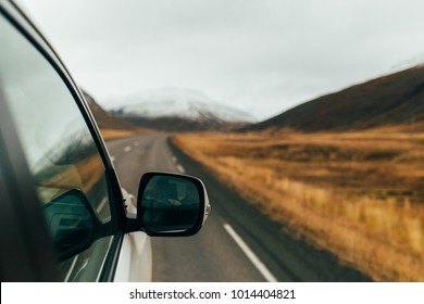 Road trip. Mountain snow view. Car trip