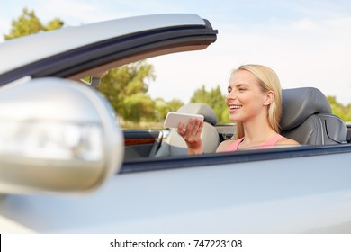 road trip, technology and communication concept - happy young woman calling on smartphone or using voice command recorder at convertible car