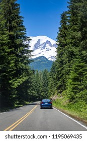 Road Trip through Mount Rainier National Park in Washington USA. View from the road looking up at the snow capped glacier of Mount Rainier