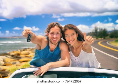 Road trip travel couple showing car keys on summer vacation. Happy young people adventure lifestyle. Carsharing, rideshare, autostop car young adults buying new car, rental insurance young people.