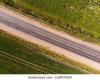 Road trough crop fields aerial view