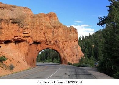 Road tunnel through red rock, Utah, USA.