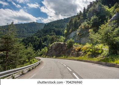 Road Turn in Mountains. Italian Alps.