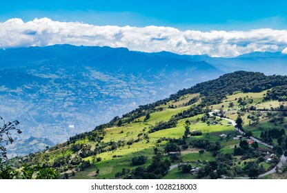 Road in a typical landscape of the mountainous area of Colombia composed of green valleys and mountains