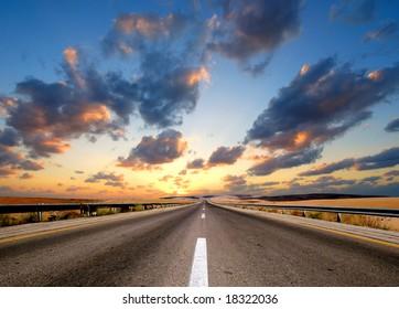 road under dramatic sky