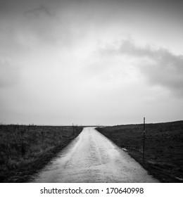 Road under a grey sky