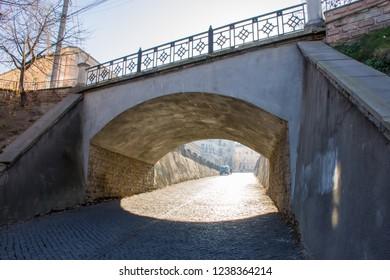 Road under the Turkish bridge. Architecture of old sity of Chernivtsi, Bukovina, Ukraine
