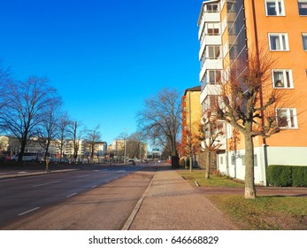 Road view in cityscape in winter season with navy blue sky background, Karlstad, Sweden
