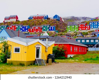 Road view of houses in Qaqortoq, Greenland. The town is in southern Greenland and has almost 4,000 residents.