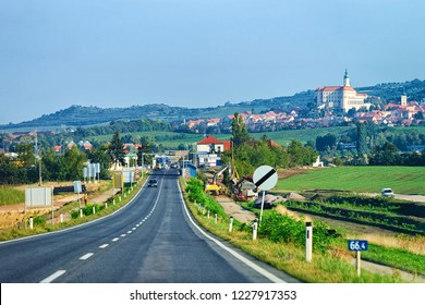 Road view with Mikulov Castle in South Moravia, in Czech Republic.