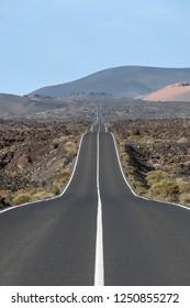 Road in the volcanic area Timanfaya National Park, Lanzarote, Spain