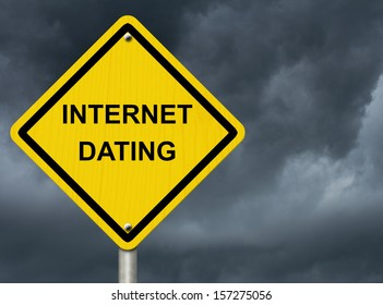 A road warning sign against a stormy sky with words Internet Dating, Warning about Internet Dating