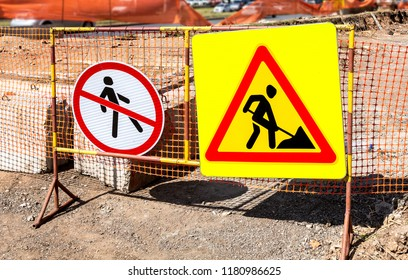 Road warning signs at the construction site