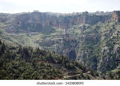 Road and waterfall in Quadisha valley, Lebanon