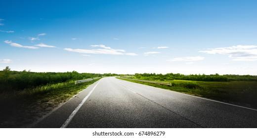Road way forward direction. Summer day landscape