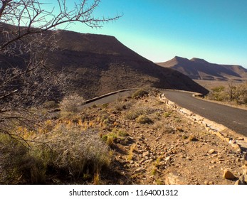 Road winding up through the beautiful Klipspringer Pass toward the escarpment. Taken in the Karoo National Park, a semi-desert region in the Western Cape of South Africa.