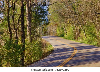 Road winding through the countryside during fall