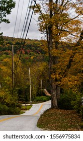 A road winding through the fall foliage in Souther Vermont