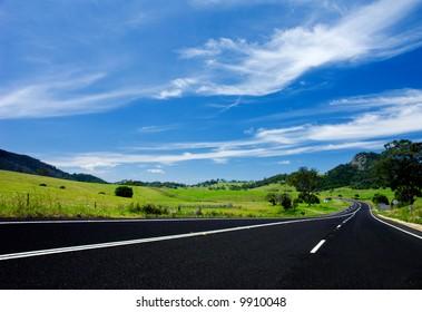 Road winding through gorgeous meadows