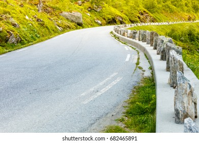 Road winding through norwegian mountains. Beautiful landscape. Travel and tourism.