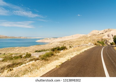Road winding through Pag island with typical landscape, Adriatic coast, Dalmatia, Croatia