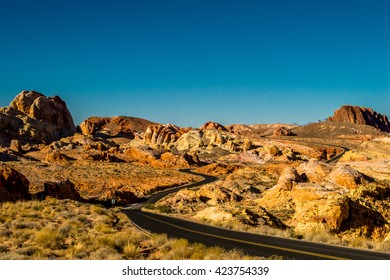 Road Winds through Rocky Desert Landscape in Valley of Fire
