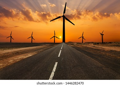 Road and windturbines on an amazing sunset.